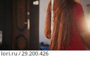 Sexy girl in red dress with flying hair pole dance. Close up. Стоковое видео, видеограф Константин Шишкин / Фотобанк Лори