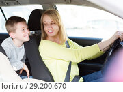 Купить «Woman and boy using car during sightseeing tour», фото № 29200670, снято 18 марта 2017 г. (c) Яков Филимонов / Фотобанк Лори