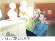 Купить «Mother and son regarding ancient statues», фото № 29200678, снято 18 марта 2017 г. (c) Яков Филимонов / Фотобанк Лори