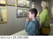 Купить «Mother and son looking at paintings in halls of museum», фото № 29200686, снято 18 марта 2017 г. (c) Яков Филимонов / Фотобанк Лори