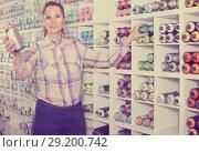Купить «portrait of woman choosing paint color in aerosol can in art shop», фото № 29200742, снято 12 апреля 2017 г. (c) Яков Филимонов / Фотобанк Лори