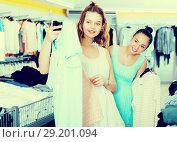 Купить «Young women shopping at the clothing store», фото № 29201094, снято 19 июня 2017 г. (c) Яков Филимонов / Фотобанк Лори