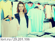 Купить «Woman shopping at the apparel store», фото № 29201106, снято 19 июня 2017 г. (c) Яков Филимонов / Фотобанк Лори
