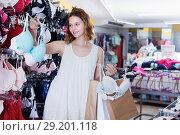 Купить «Female choosing pretty bra in lingerie store», фото № 29201118, снято 19 июня 2017 г. (c) Яков Филимонов / Фотобанк Лори