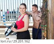 Купить «Girl with surfboard, ready to surf with coach», фото № 29201162, снято 30 апреля 2018 г. (c) Яков Филимонов / Фотобанк Лори