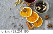 Купить «hot mulled wine, orange slices, raisins and spices», видеоролик № 29201190, снято 7 октября 2018 г. (c) Syda Productions / Фотобанк Лори