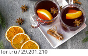 Купить «glasses of hot mulled wine with orange and spices», видеоролик № 29201210, снято 7 октября 2018 г. (c) Syda Productions / Фотобанк Лори