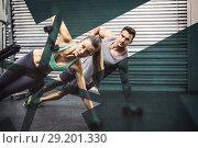 Купить «Smiling muscular couple doing side plank», фото № 29201330, снято 23 июля 2019 г. (c) Wavebreak Media / Фотобанк Лори