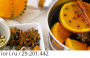 Купить «spices and hot mulled wine with orange slices», видеоролик № 29201442, снято 7 октября 2018 г. (c) Syda Productions / Фотобанк Лори