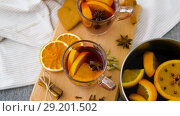 Купить «glasses of hot mulled wine with orange and spices», видеоролик № 29201502, снято 7 октября 2018 г. (c) Syda Productions / Фотобанк Лори