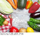 Купить «Fresh vegetables laid out around on a white wooden table», фото № 29201714, снято 9 октября 2018 г. (c) Элина Гаревская / Фотобанк Лори