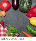 Купить «Vegetables laid out around on a black background with a napkin and herbs», фото № 29201982, снято 10 октября 2018 г. (c) Элина Гаревская / Фотобанк Лори