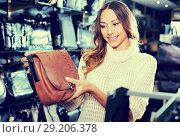 Купить «Ordinary female choosing bag among assortment», фото № 29206378, снято 15 ноября 2018 г. (c) Яков Филимонов / Фотобанк Лори