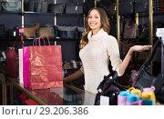 Купить «Portrait of woman selling wallets and purses», фото № 29206386, снято 21 октября 2018 г. (c) Яков Филимонов / Фотобанк Лори