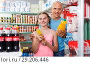 Купить «male and girl buying drinks», фото № 29206446, снято 4 июля 2018 г. (c) Яков Филимонов / Фотобанк Лори
