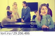 Nice new female student feeling shy at recess. Стоковое фото, фотограф Яков Филимонов / Фотобанк Лори