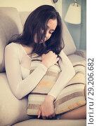 Купить «sad female sitting with pillow», фото № 29206682, снято 30 мая 2017 г. (c) Яков Филимонов / Фотобанк Лори