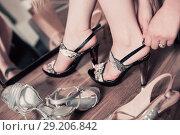 Купить «Female is trying on brilliant heeled summer sandals», фото № 29206842, снято 27 мая 2017 г. (c) Яков Филимонов / Фотобанк Лори