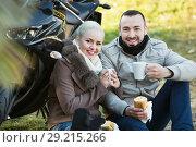 Купить «Positive young smiling couple having picnic with coffee», фото № 29215266, снято 12 октября 2018 г. (c) Яков Филимонов / Фотобанк Лори