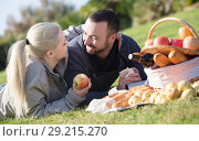 Couple lounging at picnic outdoors. Стоковое фото, фотограф Яков Филимонов / Фотобанк Лори