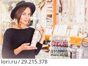 Купить «woman in hat choosing stylish bracelets», фото № 29215378, снято 16 октября 2017 г. (c) Яков Филимонов / Фотобанк Лори