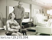 Купить «Clients are testing new furniture», фото № 29215394, снято 16 мая 2017 г. (c) Яков Филимонов / Фотобанк Лори