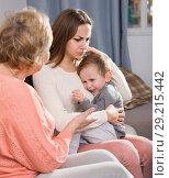 Купить «Two women are quarreling for upbringing toddler», фото № 29215442, снято 15 февраля 2018 г. (c) Яков Филимонов / Фотобанк Лори