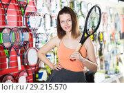 Купить «Smiling girl standing in sporting goods store», фото № 29215570, снято 15 мая 2017 г. (c) Яков Филимонов / Фотобанк Лори