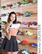 Купить «Young female choosing professional shoes», фото № 29215578, снято 15 мая 2017 г. (c) Яков Филимонов / Фотобанк Лори