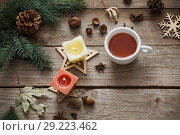 Купить «candles and Christmas decoration on wooden background», фото № 29223462, снято 14 ноября 2017 г. (c) Майя Крученкова / Фотобанк Лори