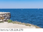 Купить «View of the Black Sea from the Crimean coast. Russia, the Republic of Crimea, the city of Sevastopol. 11.06.2018: The ruins of the ancient and medieval city of Chersonese Tauride», фото № 29224270, снято 11 июня 2018 г. (c) Вадим Орлов / Фотобанк Лори
