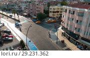 Купить «Sunny day, street of resort town, panorama from above of the city», видеоролик № 29231362, снято 20 октября 2018 г. (c) Сергей Тимофеев / Фотобанк Лори