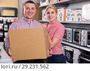 Купить «Couple holding packed purchases in store of household appliances», фото № 29231562, снято 1 марта 2018 г. (c) Яков Филимонов / Фотобанк Лори
