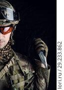 Купить «military man with a sharp steel knife in his hand», фото № 29233862, снято 4 апреля 2017 г. (c) katalinks / Фотобанк Лори