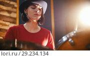 Купить «Repetition. Girl in black hat enthusiastically plays the drums. Slow motion», видеоролик № 29234134, снято 8 июля 2020 г. (c) Константин Шишкин / Фотобанк Лори