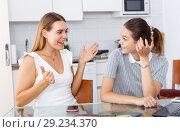 Купить «Two girls having emotional conversation», фото № 29234370, снято 2 августа 2018 г. (c) Яков Филимонов / Фотобанк Лори