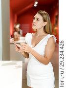 Купить «Woman observing museum exposition», фото № 29234426, снято 28 июля 2018 г. (c) Яков Филимонов / Фотобанк Лори