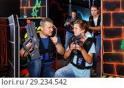Купить «Happy teen boy with laser gun having fun on lasertag arena with his father», фото № 29234542, снято 3 сентября 2018 г. (c) Яков Филимонов / Фотобанк Лори