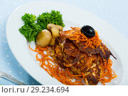 Купить «Vegetarian dish, carrots pancakes with mushrooms served at black plate», фото № 29234694, снято 21 ноября 2018 г. (c) Яков Филимонов / Фотобанк Лори