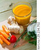 Купить «Freshly squeezed carrot-ginger juice», фото № 29234702, снято 20 мая 2019 г. (c) Яков Филимонов / Фотобанк Лори