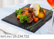 Купить «Tasty chicken hearts with baked vegetables and fresh pear at plate», фото № 29234722, снято 21 октября 2018 г. (c) Яков Филимонов / Фотобанк Лори