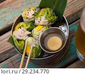 Купить «Ceviche rolls from white fish with rice paper in vietnamese style», фото № 29234770, снято 16 декабря 2018 г. (c) Яков Филимонов / Фотобанк Лори