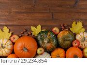 Купить «Pumpkins on wooden background», фото № 29234854, снято 15 октября 2017 г. (c) Иван Михайлов / Фотобанк Лори