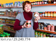 Купить «woman buyer choosing canned fish food in tin at the supermarket», фото № 29240774, снято 15 декабря 2017 г. (c) Яков Филимонов / Фотобанк Лори