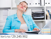 Купить «Female employee is sleeping after productive day at work», фото № 29240902, снято 9 июня 2017 г. (c) Яков Филимонов / Фотобанк Лори