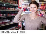 Купить «Glad female searching for reliable nail polish», фото № 29241058, снято 21 февраля 2017 г. (c) Яков Филимонов / Фотобанк Лори