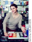 Купить «Young girl seller is displaying assortment», фото № 29241070, снято 21 февраля 2017 г. (c) Яков Филимонов / Фотобанк Лори