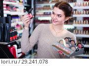 Купить «Young customer is searching for reliable blushes», фото № 29241078, снято 21 февраля 2017 г. (c) Яков Филимонов / Фотобанк Лори