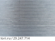 Купить «Industrial abstract steel background. The texture of the new aluminum car radiator», фото № 29247714, снято 2 сентября 2018 г. (c) Светлана Евграфова / Фотобанк Лори
