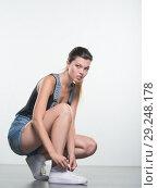 Купить «Young woman in shorts», фото № 29248178, снято 10 августа 2018 г. (c) Типляшина Евгения / Фотобанк Лори